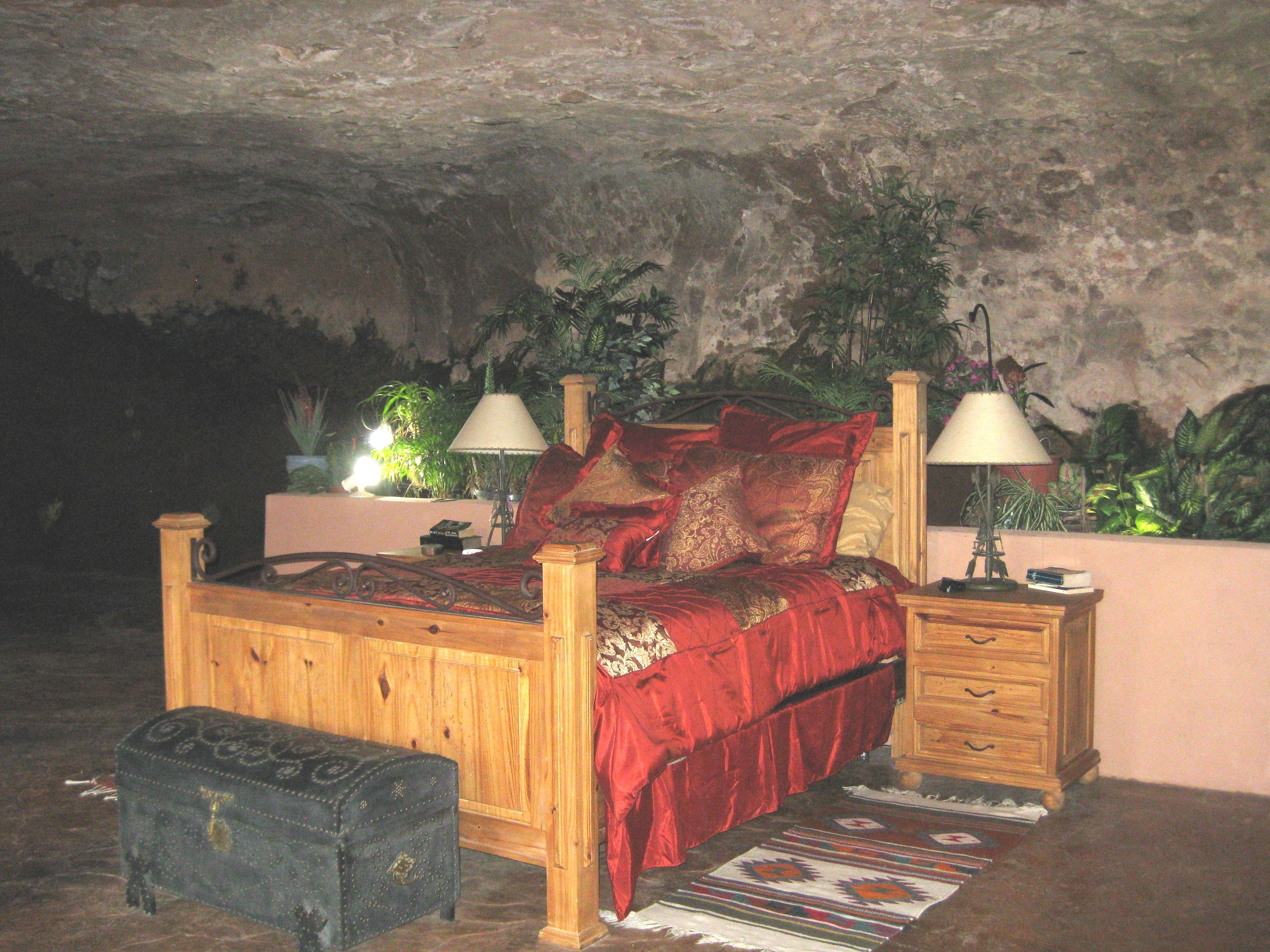 Bedroom in a cave home cave house dwell earth sheltered