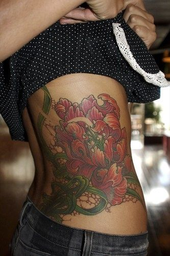 Pin By Cal On Colorful Tattoos On Dark Skinned People Flower Tattoo Back Tattoo Lily Flower Tattoos