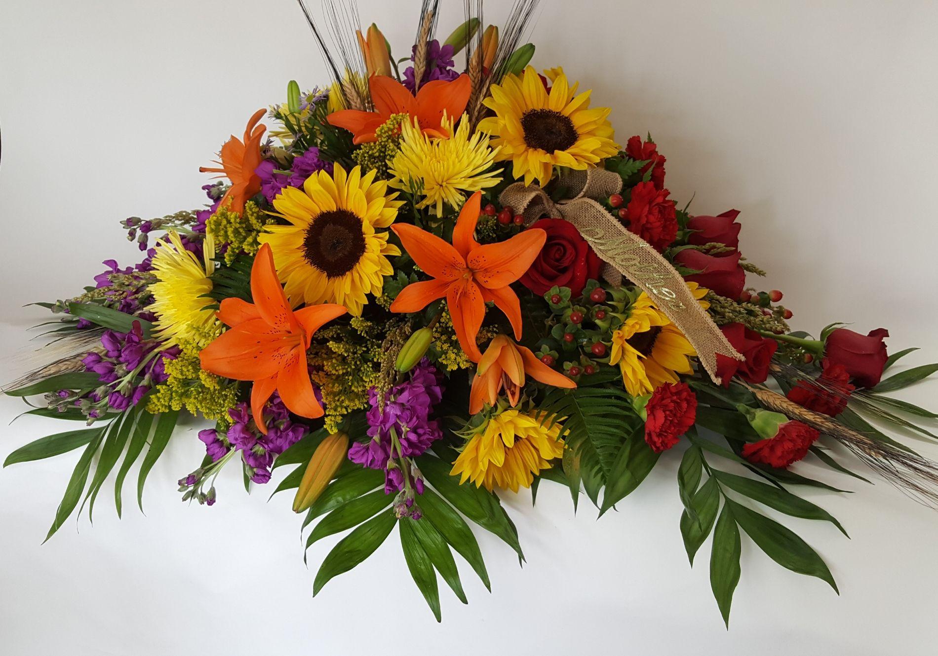 Fall themed casket spray @flowersbyaprilct