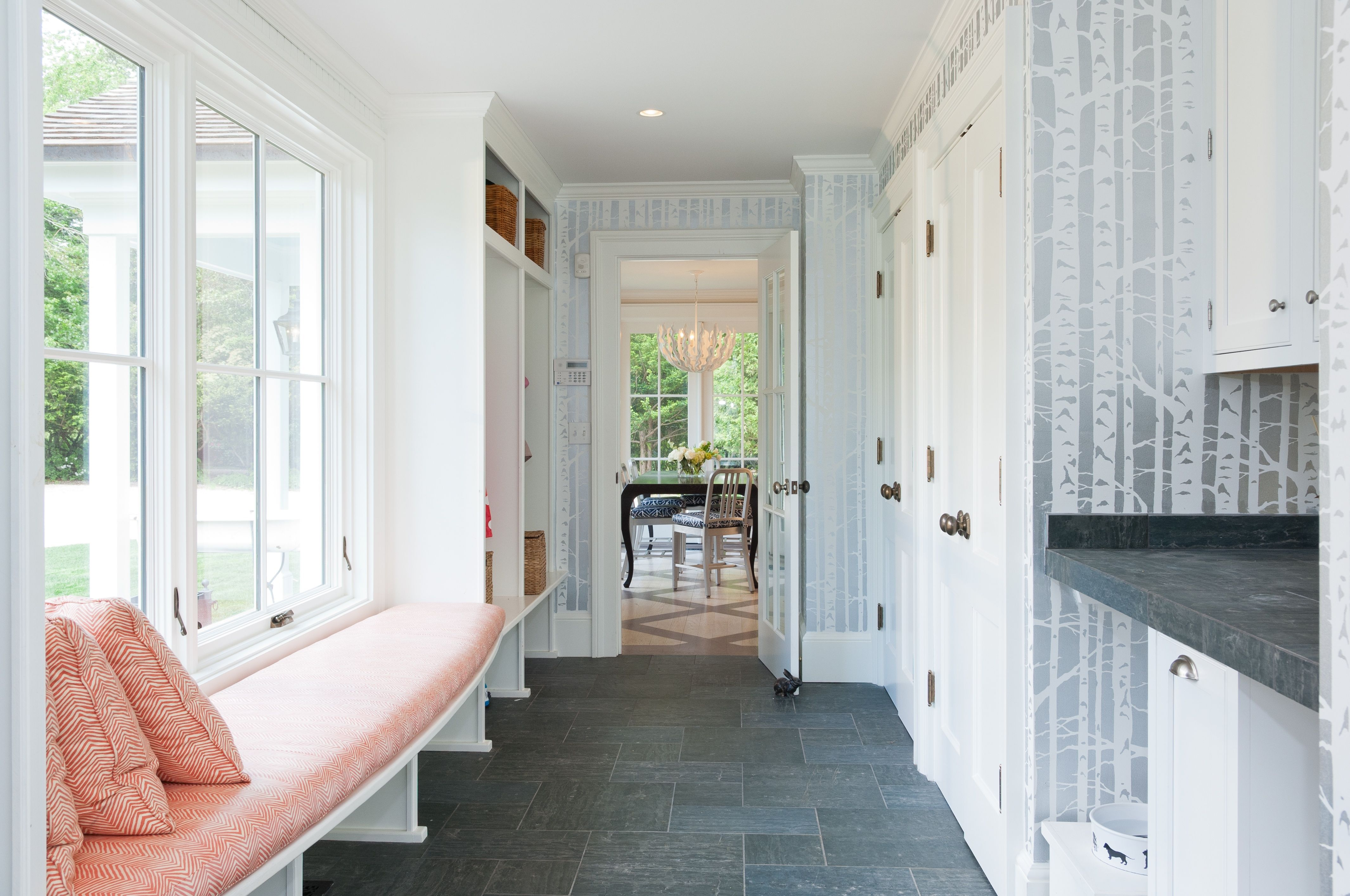This mudroom with cubbies for each child allows a clutter free entry way