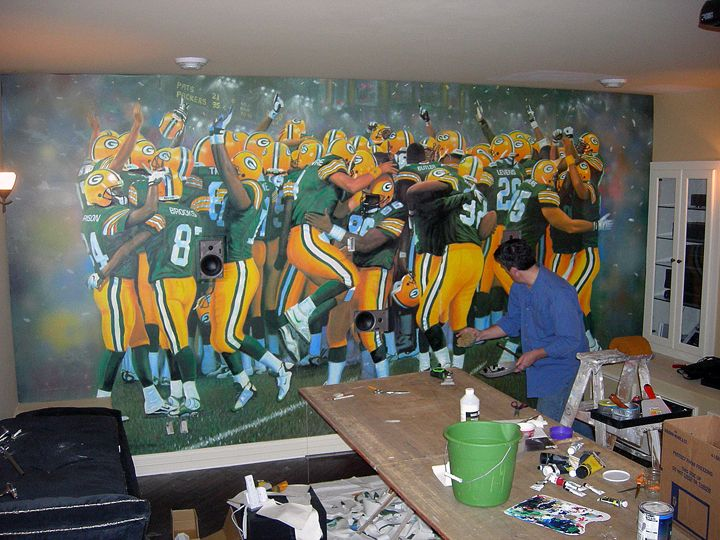 Sports Wall Murals goralski-working-on-packers-mural-for-sports-room-low-res1