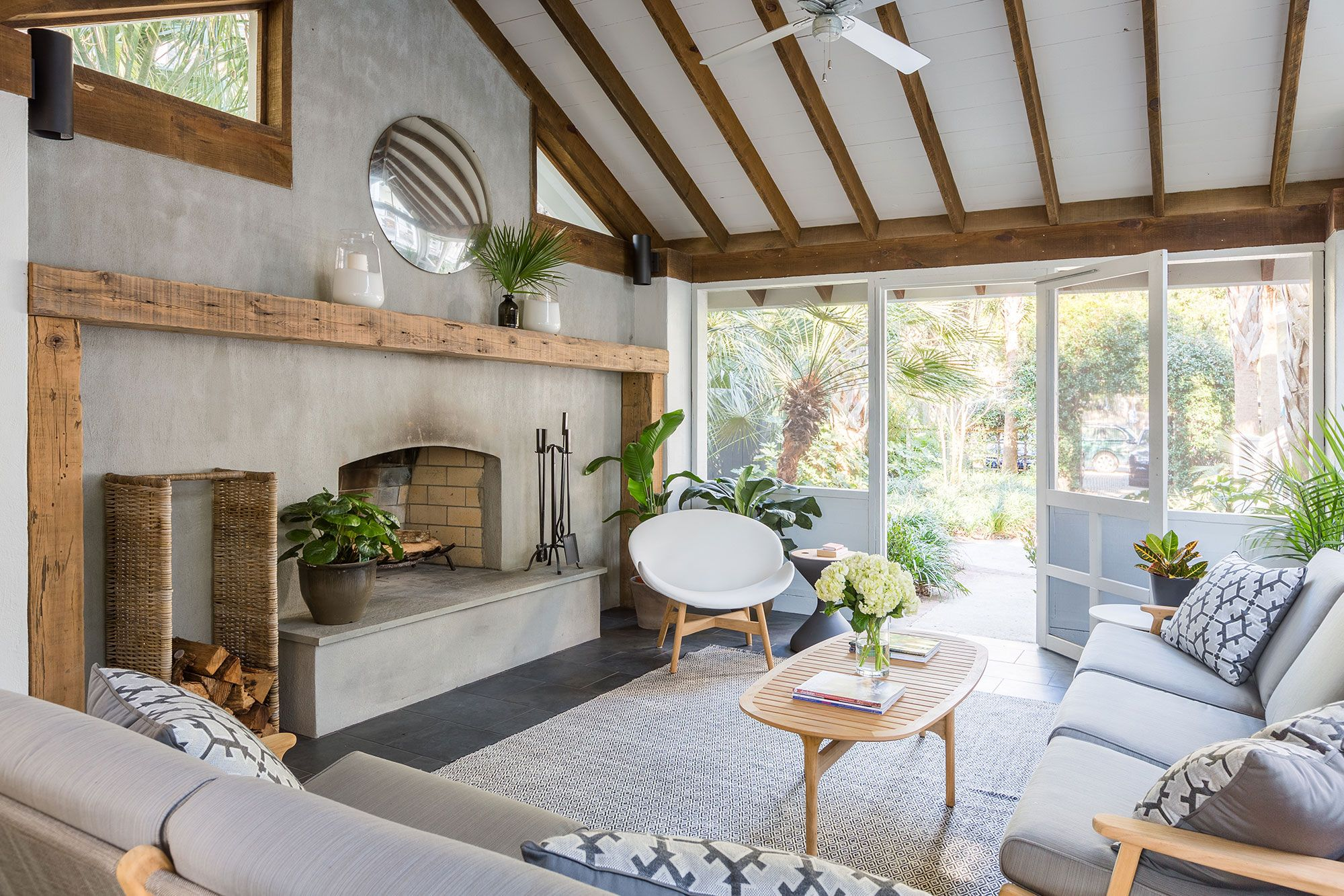 In The Cabana Seating And A Table By Gloster Are Accented By A Rug By Dash Albert And A Vi With Images Residential Interior House Decor Modern Contemporary Decor Modern