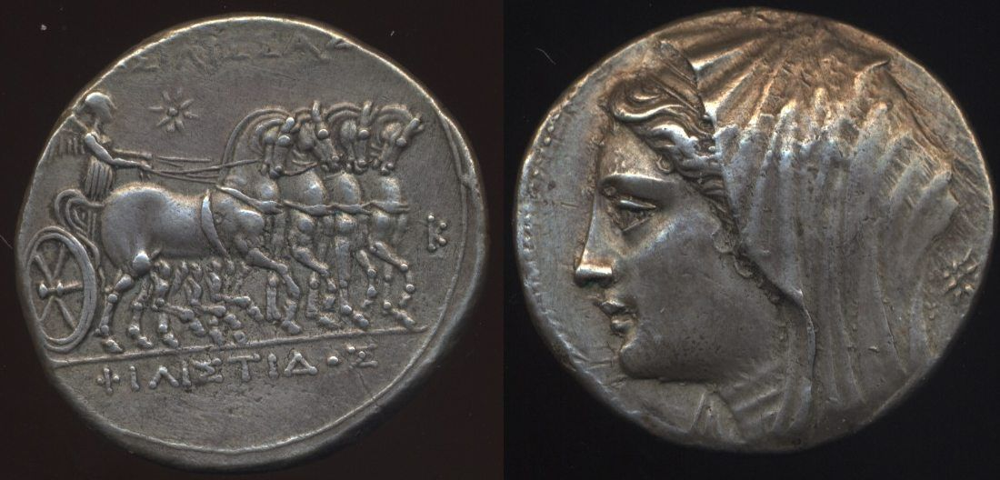 Sicily, Syracuse - 274- 216 BCE; 16 Litrae 13.49 gm. OBV: Slow quadriga right driven by Nike, star above, K before horses.  REV: Diademed and veiled head of Queen Philistis left; star behind.