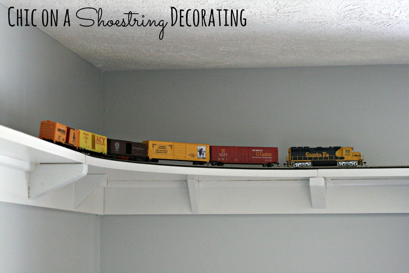 DIY HO Train track shelf around room ceiling by Chic on a Shoestring