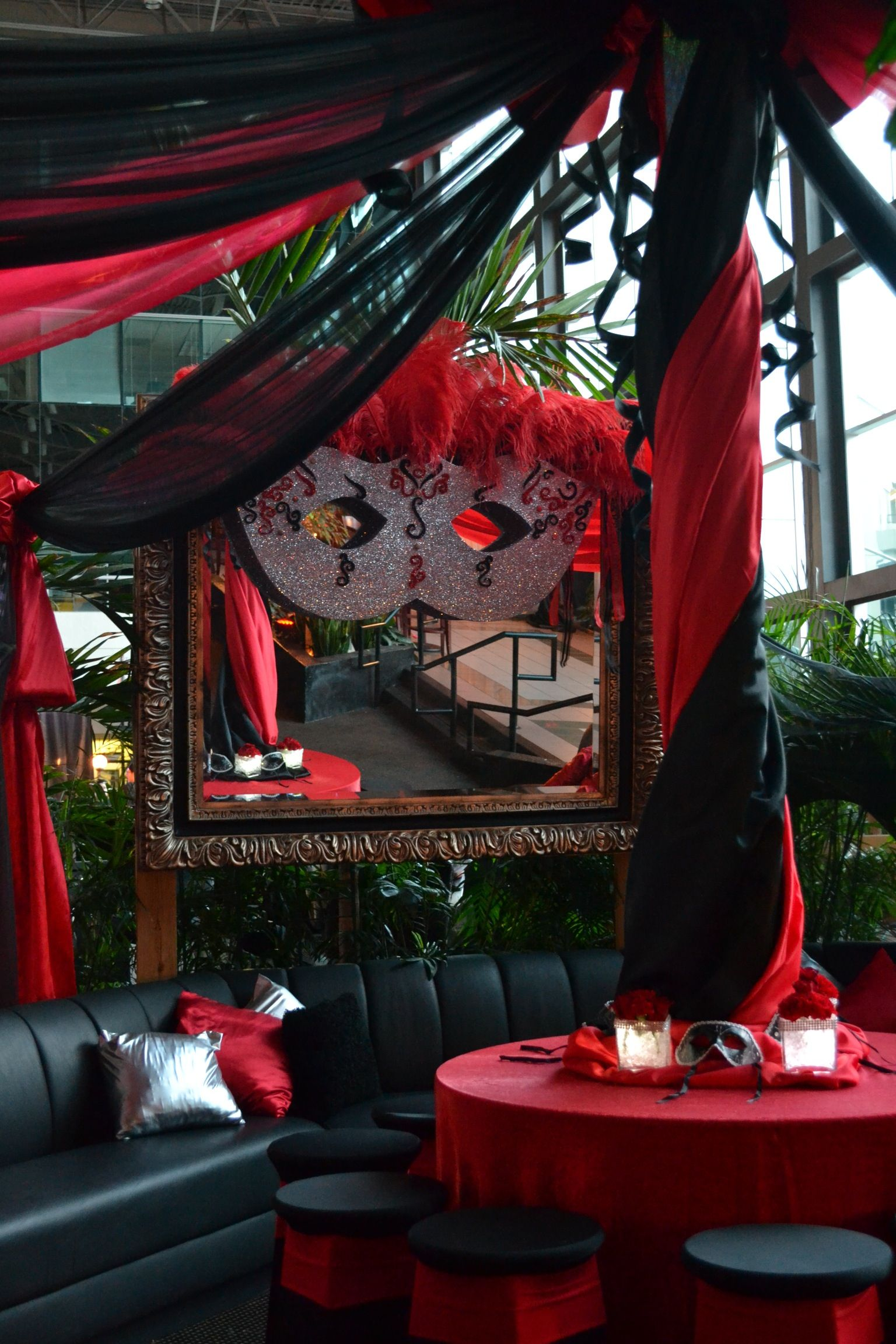 red and black decor at a masquerade ball party. Black Bedroom Furniture Sets. Home Design Ideas