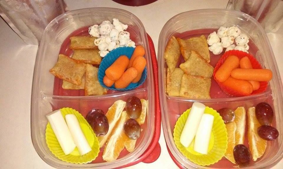 Bento Lunch box idea 12-14-15 pizz bites carrots string cheese orange slices & grapes sugar cookie popcorn