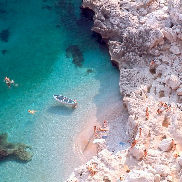 Capri, Italy >> I would love nothing more than to sit on this tiny beach! #JetsetterCurator