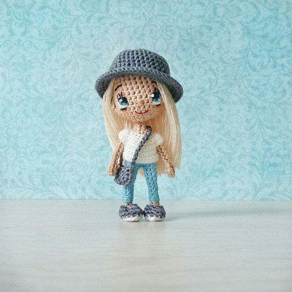 Miniature doll amigurumi crochet cotton and wool . Height 7,5 cm or 2,95. Blue eyes embroidered. Bag, hat and shoes can be removed. #miniaturetoys