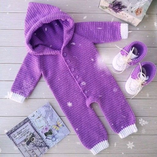 Photo of Gift set of baby clothes of purple color