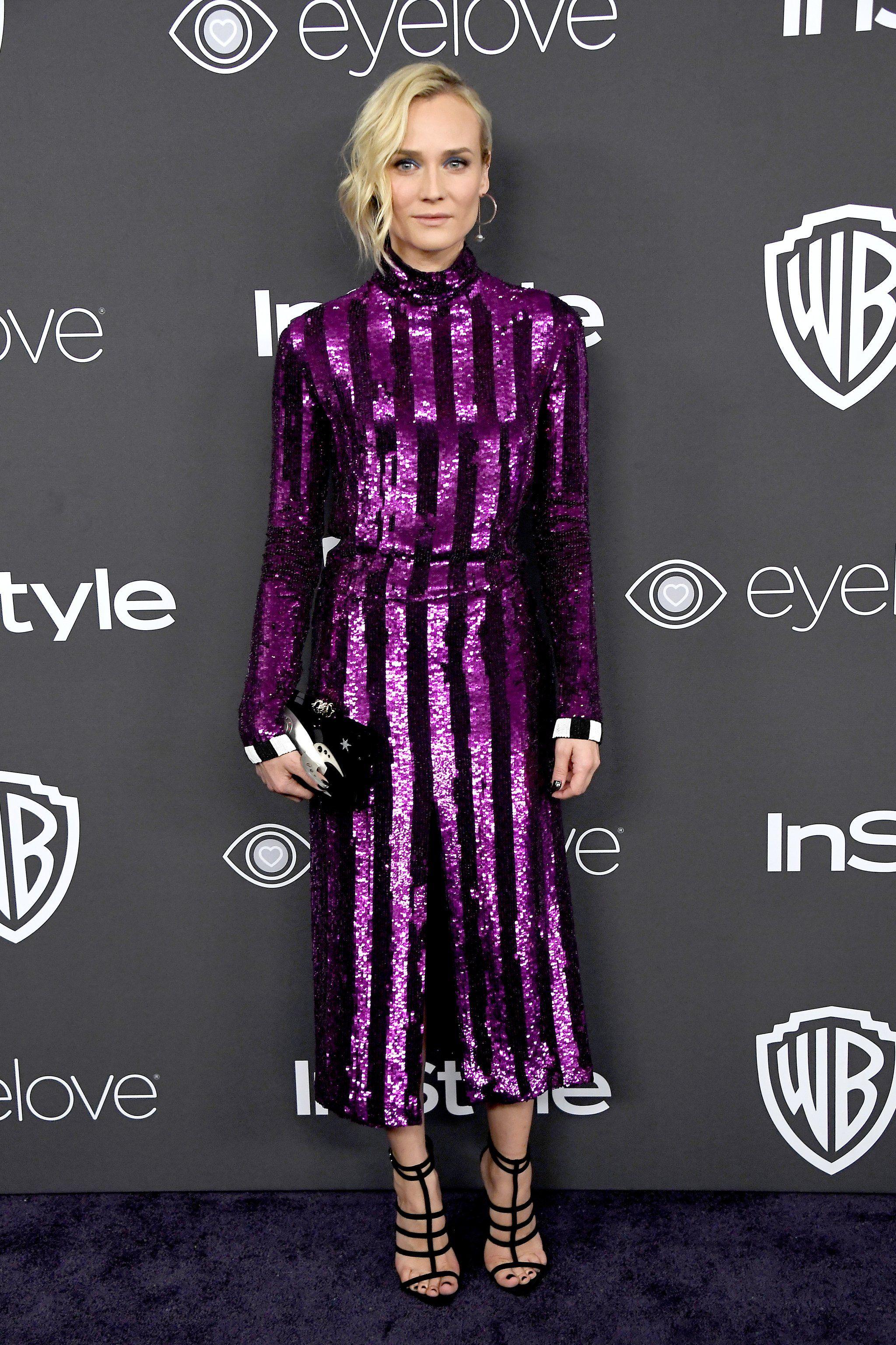 Diane Kruger in a Nina Ricci dress, Giuseppe Zanotti shoes, Charlotte Olympia clutch and Swarovski earrings