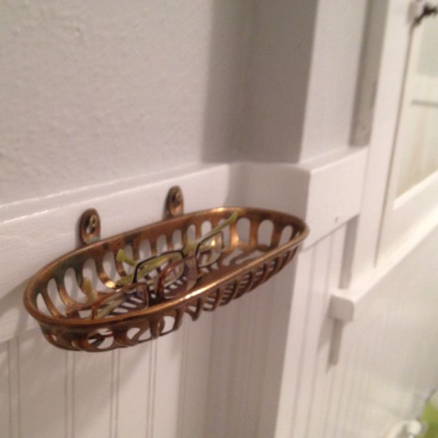 Antique soap dish to hold my glasses in the bathroom.