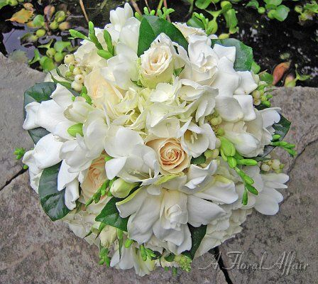 Beautiful and traditional bouquet with the sweet fragrance of gardenia, white rose, hydrangea, and freesia.  Flowers by A Floral Affair - www.afloralaffair.com #pdxweddings #weddingbouquet