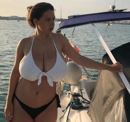 of Busty girl slips bikini out