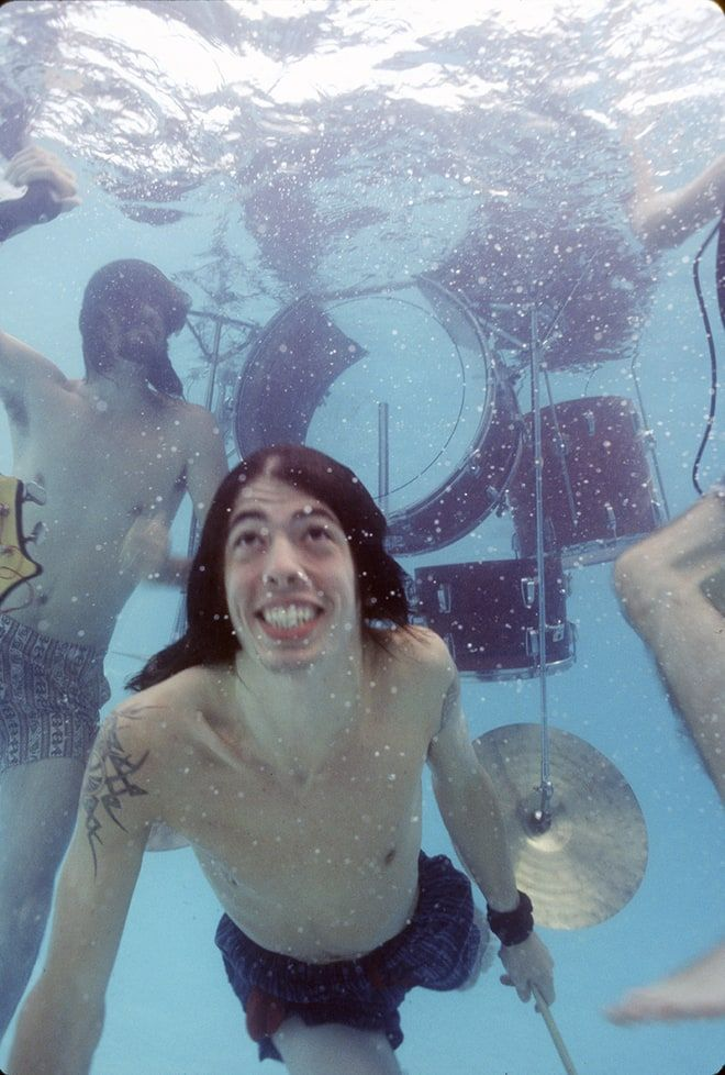 Dave Grohl takes a dive at Nirvana's 'Nevermind' pool party 25 years ago.