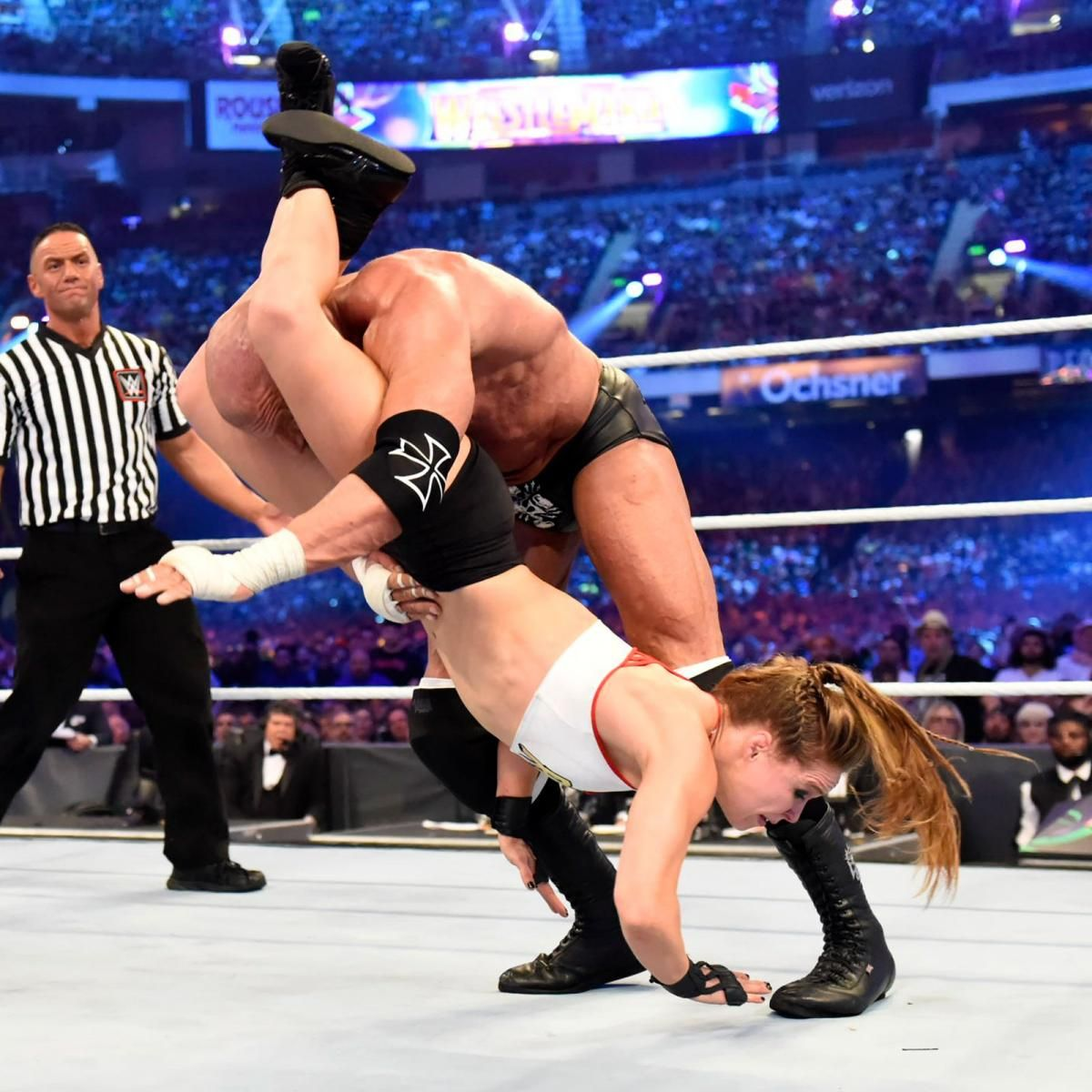 Rousey wastes no time pulling Stephanie into the ring for
