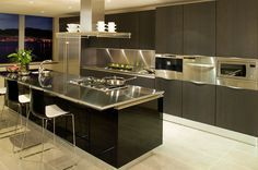 Stainless Steel with gloss black - a Chambrair Elegance wine cabinet in matching colours would look stunning in this kitchen