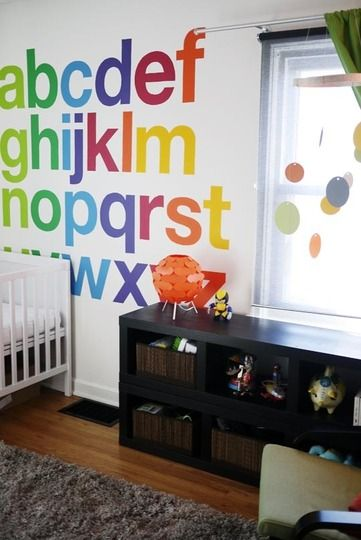 Love this hand-painted Helvetica alphabet in the nursery. Supposedly for a kid's room, but I'd fucking love this in a home office.