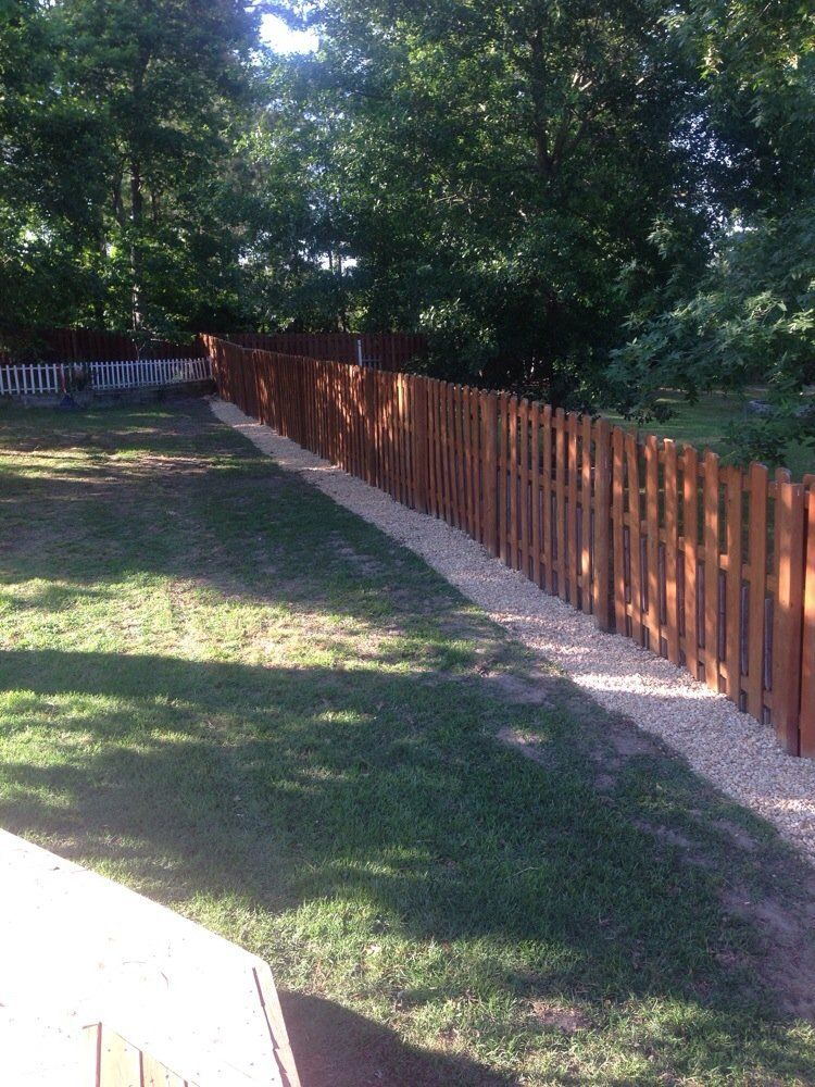 use rocks gravel or sand for mowing strip along fence - Garden Ideas Along Fence Line