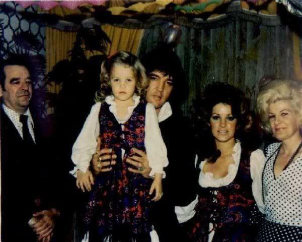 Lisa Marie, Elvis, and Priscilla Presley
