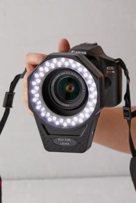 Bring vivid luminescence to your next photo shoot with this ring light by Fotodiox, constructed to fit around your camera lens with the included adaptors. Versatile design features a built-in dimmer with daylight colour temperature, operable via AC adaptor or battery and ideal for macrophotography and portraits.Features Built-in dimmer Daylight color temperature Battery-operated or plug-in Compatible with different-sized lenses via adaptors Ideal for macrophotography Content + Care Includes LED4