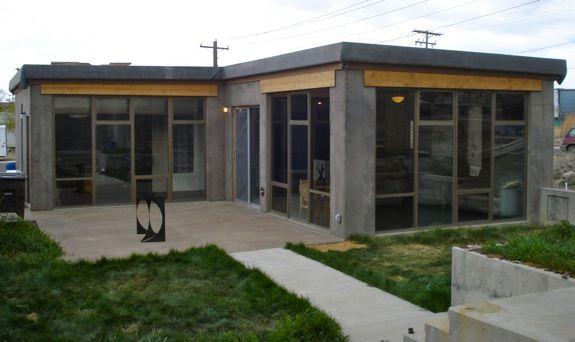 Modern Concrete Pive Solar Home