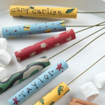 Photo of Make your own roasting sticks using wooden dowels and wire hangers.