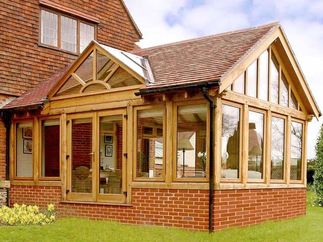 Oak framed conservatory with rosemary tile covered roof for Timber frame sunroom addition
