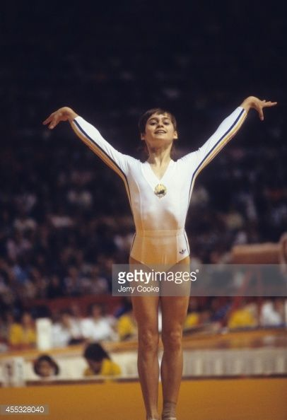 Romania Nadia Comaneci victorious after landing during Women's competition at Montreal Forum. Montreal, Canada 7/18/1976 - 7/19/1976 Jerry Cooke X20677 TK0 R29 F24 )