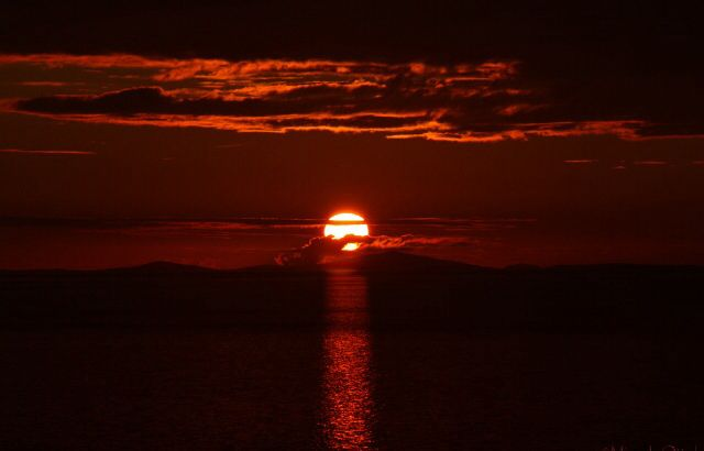 Sunset at the Isle of Skye. Outer Hebrides on the horizon.