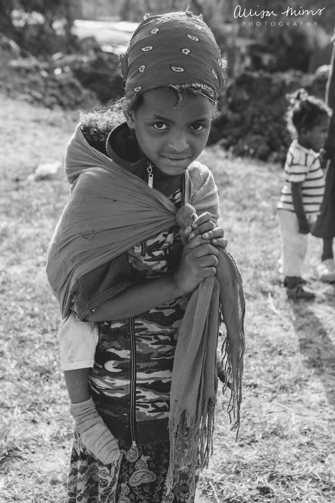 5 year old girl carrying a baby. [Ethiopia]