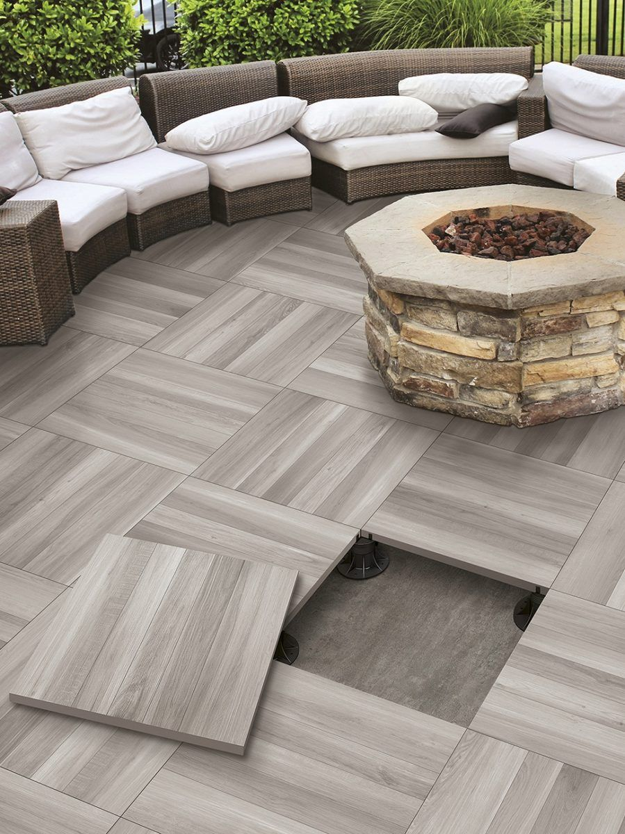 High Quality Elevated Patio Tile Floor By Serenissima With A Fire Pit Installed On It