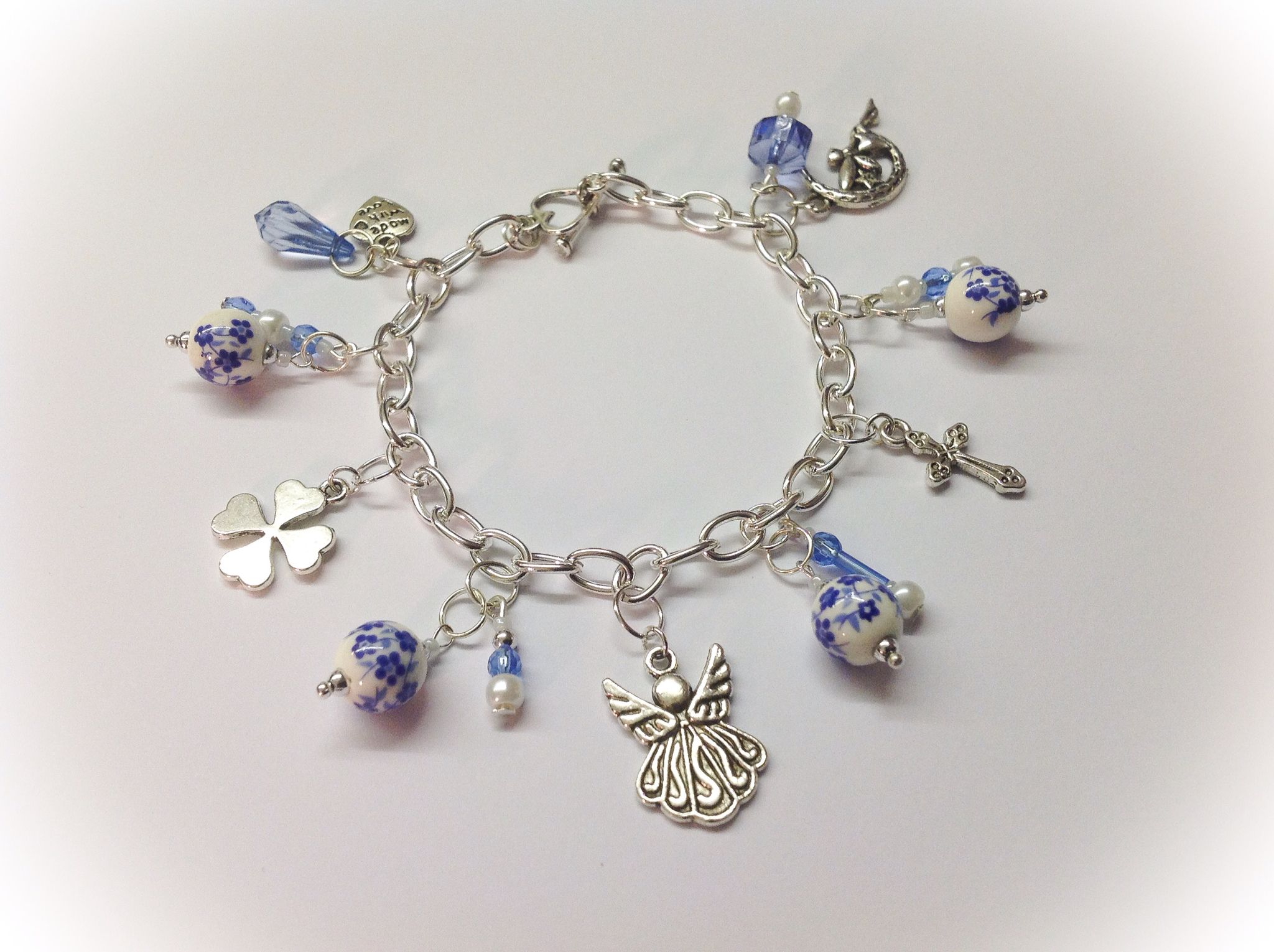 facc11f0fa7a6 Bespoke charm bracelet in shades of blue. Each charm individually ...