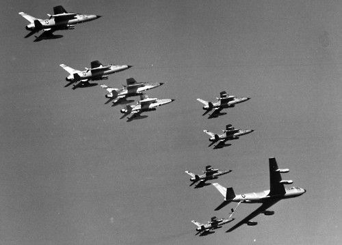 Thirsty F-105 Thunderchiefs receive fuel from a KC-135 Stratotanker on their way to targets in North Vietnam, December 1965. The KC-135 was the USAF's first all-jet tanker. (U.S. Air Force photo)