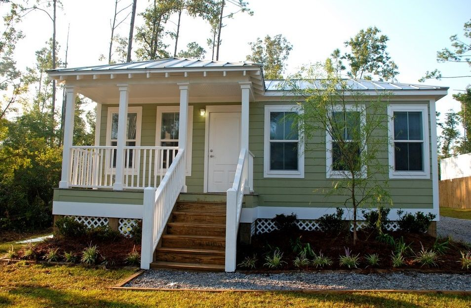 how much does a tiny house cost to build a prefab home wooden stairs wooden siding wall mounted lighting white railing & how much does a tiny house cost to build a prefab home wooden stairs ...