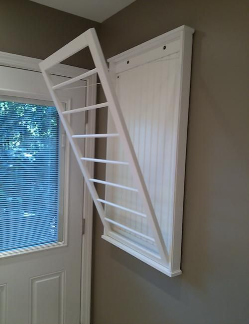 Ingeniously Simple Door With Metal Rods For Drying Clothes And