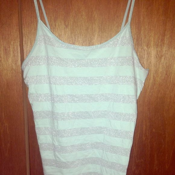 Mint green striped cami  Mint green in color with sparkly silverish striped. Very cute and by far my favorite but unfortunately I grew out of it. Very comfortable to wear and is great to look at. If you have any questions please ask! Mossimo Supply Co. Tops Camisoles
