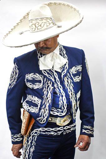 Mariachi Francisco Leyva shows off his Tello suit.source | ST Fashions | Pinterest | Charro suit