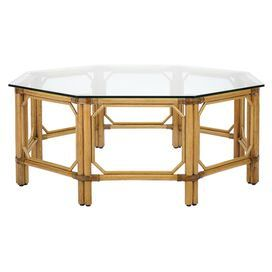 """Add stylish appeal your living room or den with this eye-catching coffee table, showcasing a rattan and wicker base and octagon-shaped glass top.  Product: Coffee tableConstruction Material: Rattan, wicker, wood and tempered glassColor: NutmegFeatures:  Octogonal-shaped designWicker accentsDimensions: 17.5"""" H x 43"""" W x 43"""" D"""