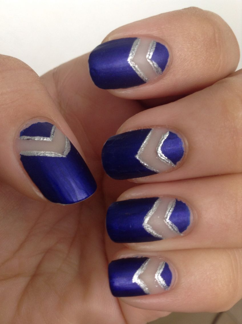 Matte blue and silver chevron design with negative space.