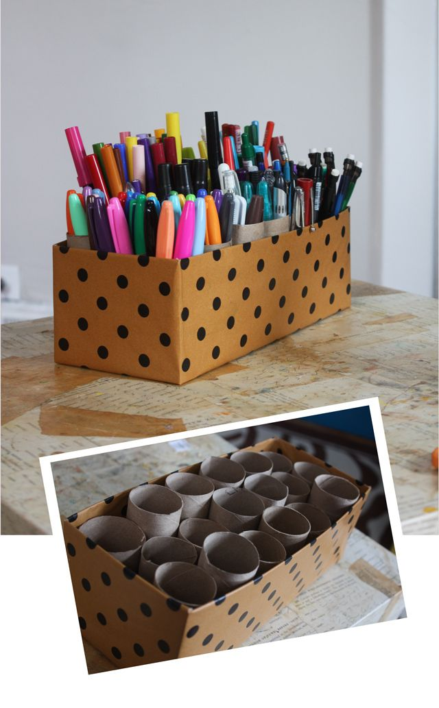 Paper covered shoebox with cardboard tube inserts (cut to varying heights) for holding markers/pens/pencils.