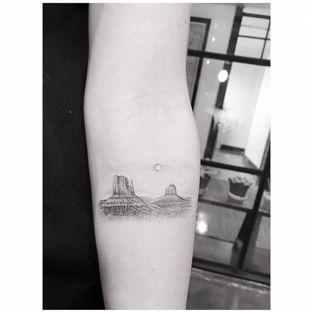 Single Needle Monument Valley Tattoo On The Left Inner