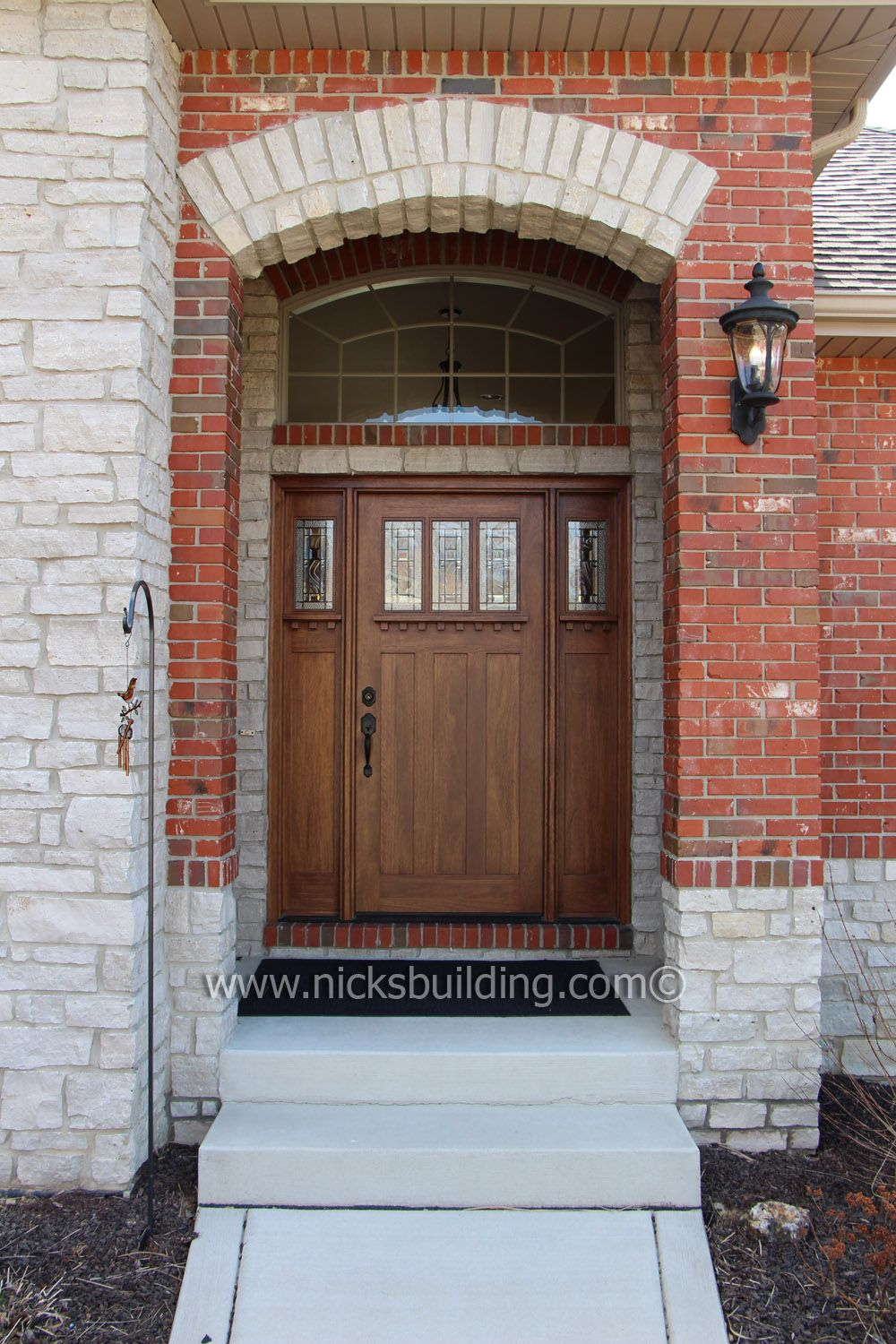 Craftsman Entry Door. A Solid Wood Door Stained In A Colonial Maple Hue  Creates An