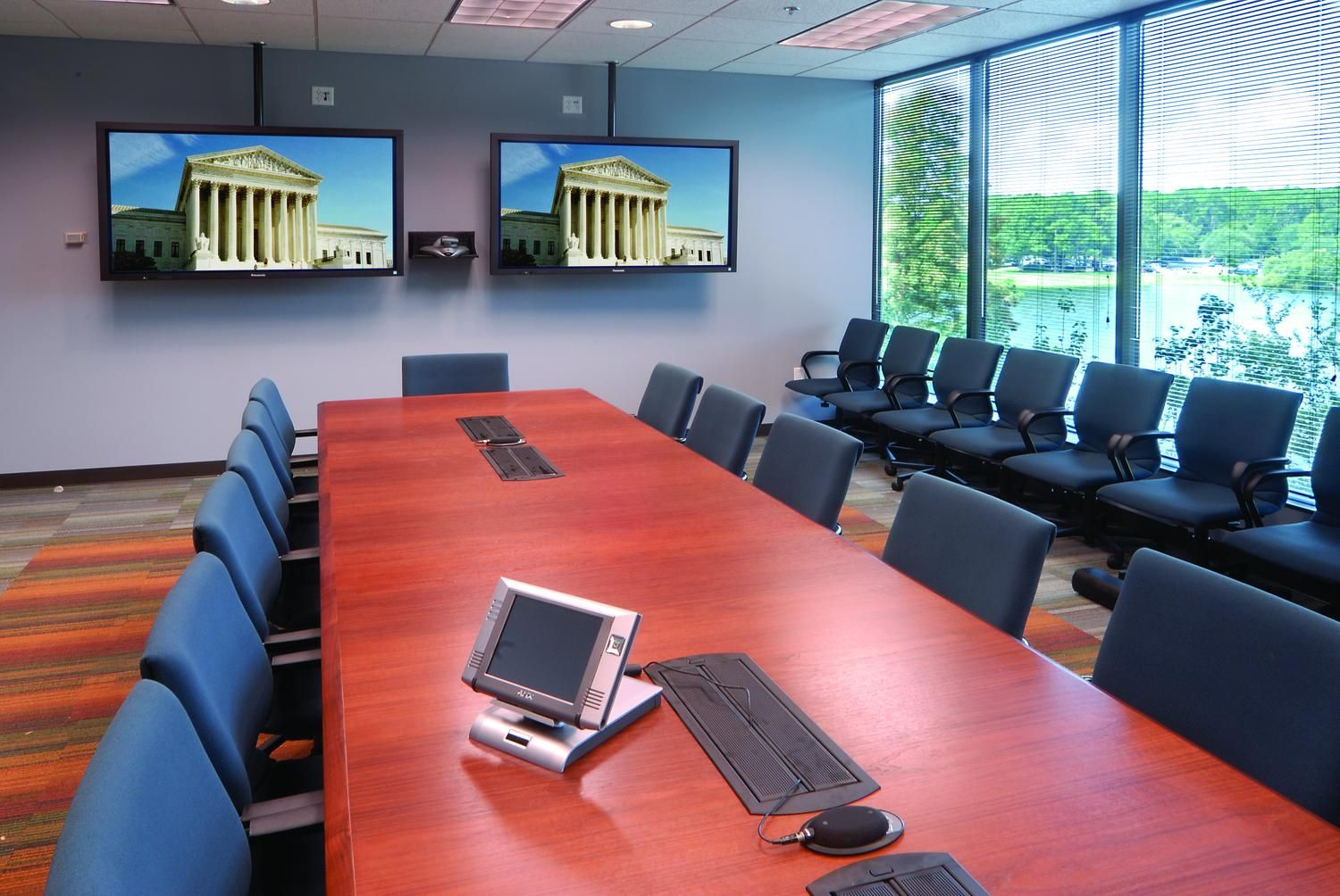 Double Flat Screens Mounted On The Wall In The Conference Room Flat Screen Mount Tv