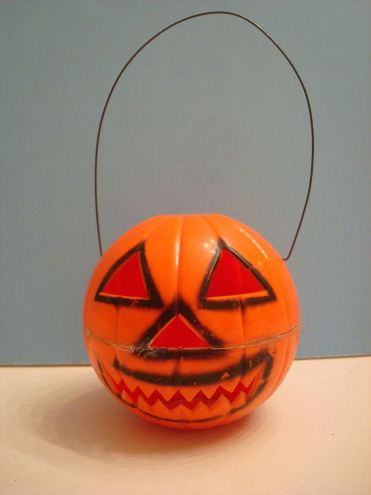 Vintage Hard Plastic Jack O Lantern, with Wire Handle, Made for Light Topper. I have one of these in excellent condition.  It's so cool.  I have posted this before but who cares, I like looking at it.  Too bad it has damage or it would be living with me.  I call mine Jagger!!!