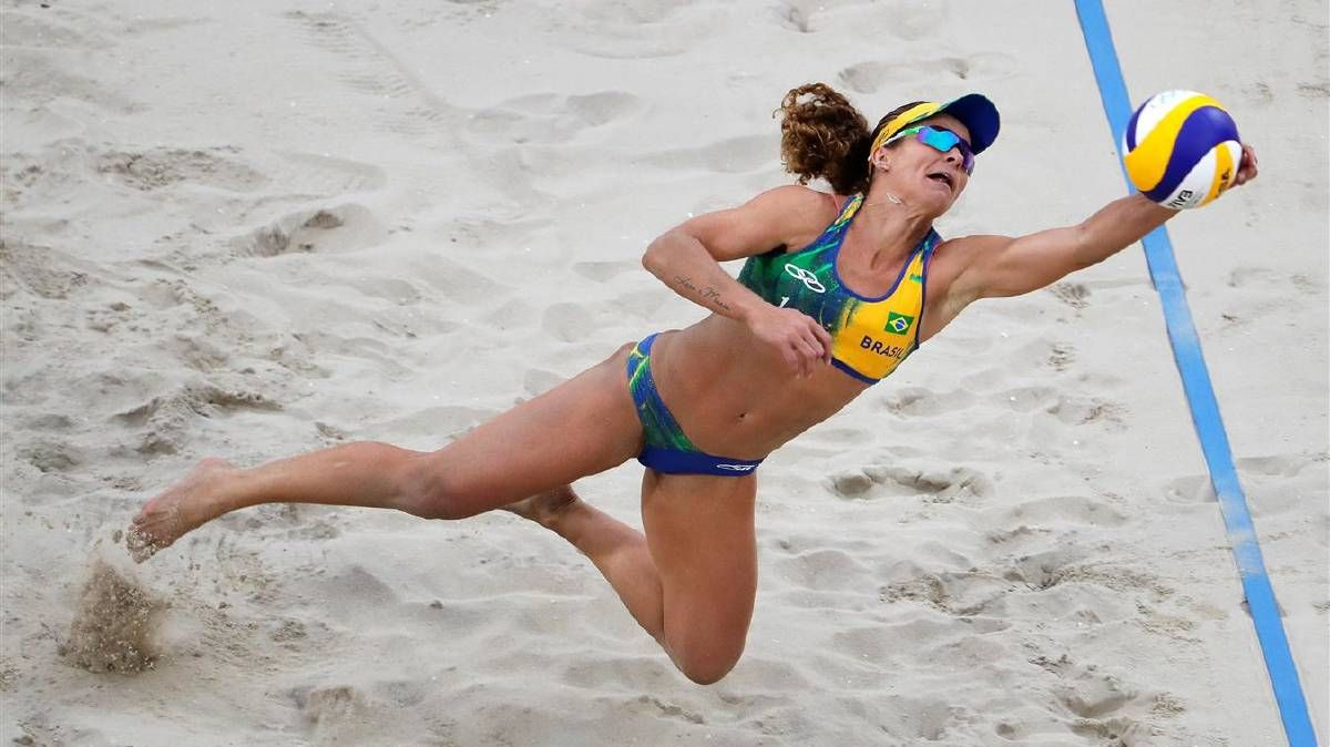 Larissa Franca Maestrini Of Brazil Picks Up The Ball On The Playing Against Laura Ludwig And Kira Walkenhorst Of Germany During The Beach Volleyball Women S Sem