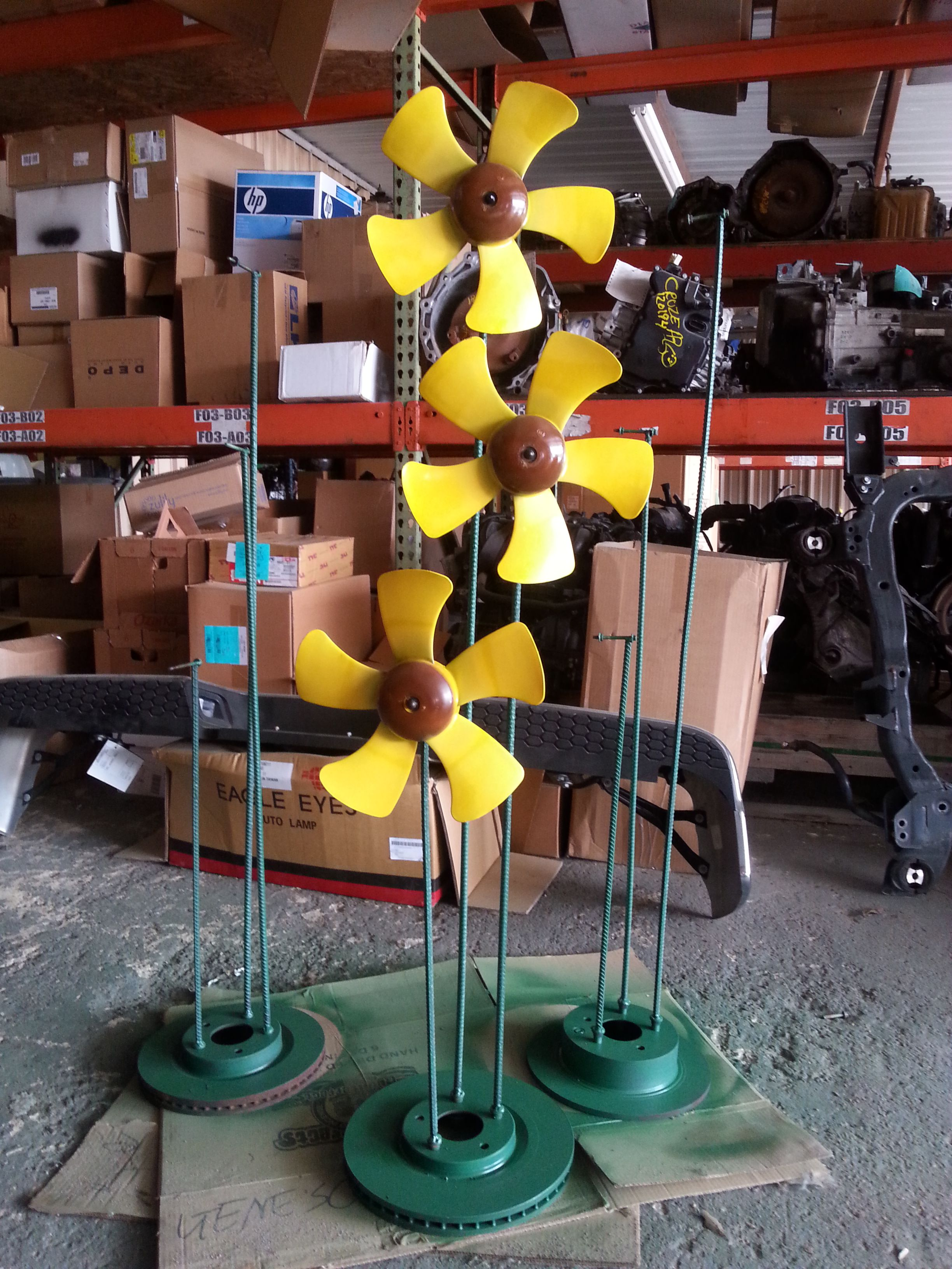 Diy recycled car part yard art sunflowers flower yard art