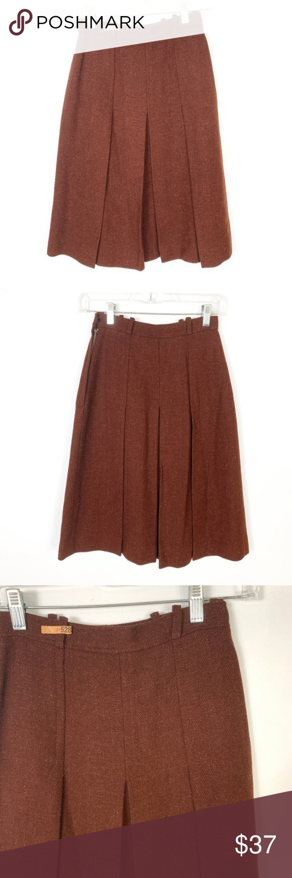 "Nina Ricci Pleated Skirt Wool Brown A Lined Lined Nina Ricci Pleated Skirt Wool Brown A Lined Lined Career Work Modest. Vintage Size 9. Waist measurements approx 25"" Gently preowned condition with no rips, holes, or stains. Please see pictures for approx measurements flatlays, relaxed, unstretched.   060819-071619-.45 Vintage Skirts"