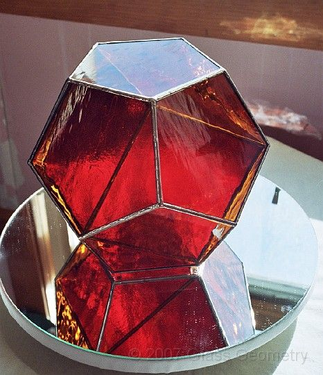 Golden Dodecahedron, representing Man, with a red Cube ...