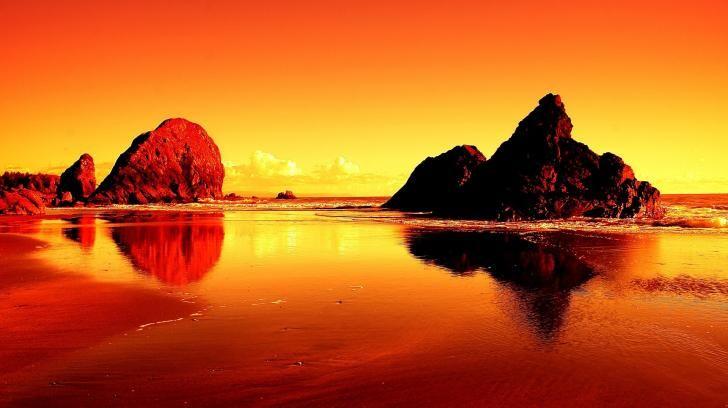 Un Bello Sfondo In Alta Definizione Di Un Tramonto Su Una Spiaggia