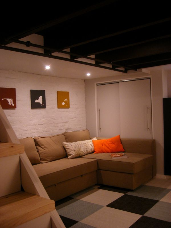 delightful Cute Basement Ideas Part - 1: Cute basement ideas: carpet squares, simple wall art and a cumphy couch.